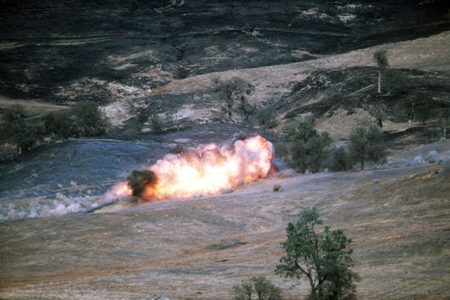 Mark 82 500-pound bombs, dropped by A-10 Thunderbolt II aircraft from the 357th Tactical Fighter Training Squadron, detonate on a target area during the joint US Army/Air Force Exercise CALFEX'86 (combined arms live fire exercise)