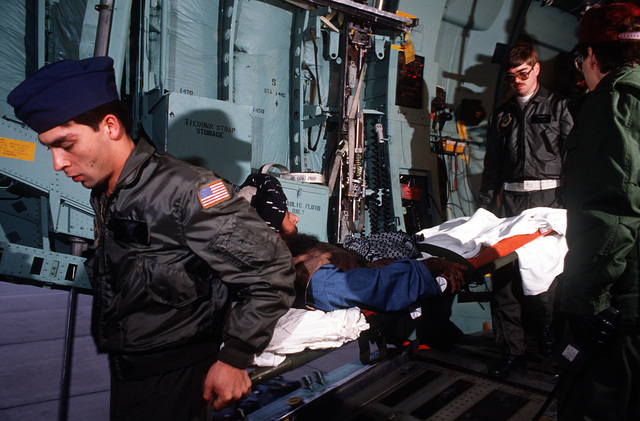 Medics from the 2nd Aeromedical Evacuation Squadron remove wounded Afghan freedom fighters from a C-141B Starlifter aircraft. The freedom fighters are being transported to the Wiesbaden Regional Medical Center for an overnight layover while en route from