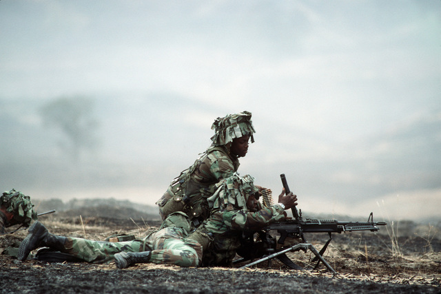 Soldiers of the 7th Infantry Division fire an M60 machine gun during the joint US Army/Air Force Exercise CALFEX'86 (combined arms live fire exercise)