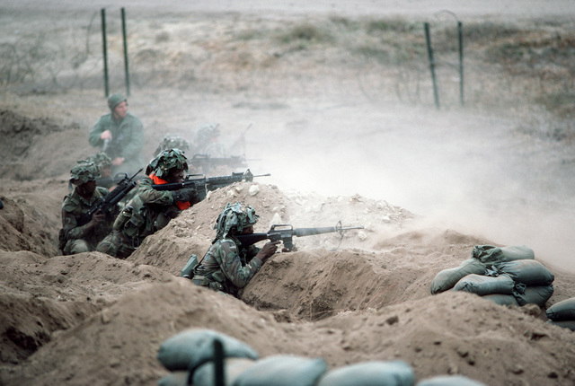 Soldiers of the 7th Infantry Division fire M16A1 rifles from a trench during the joint US Army/Air Force Exercise CALFEX'86 (combined arms live fire exercise).  Two of the rifles are equipped with M203 40 mm grenade launchers
