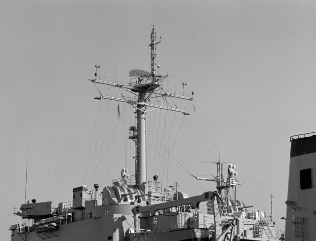 A port quarter view of the mast and superstructure of the tank landing ship USS BARBOUR COUNTY (LST 1195)