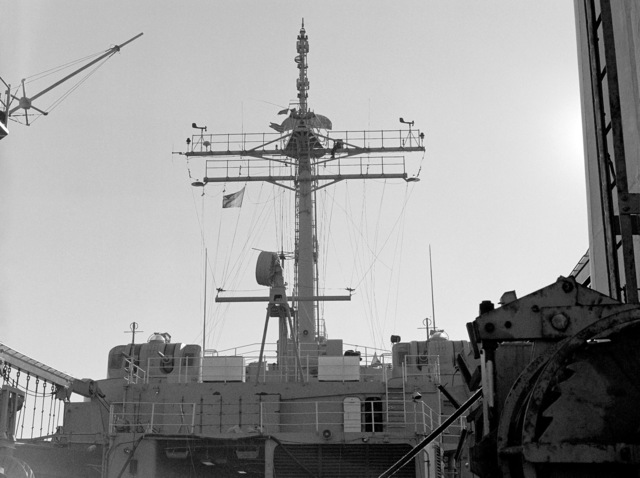 A view from the stern looking forward at the mast and superstructure of the tank landing ship USS BARBOUR COUNTY (LST 1195)
