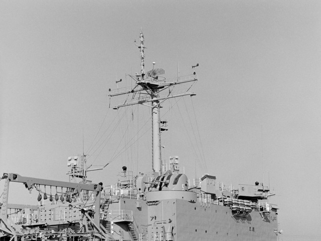 Starboard amidships view of the mast and superstructure of the tank landing ship USS BARBOUR COUNTY (LST 1195)