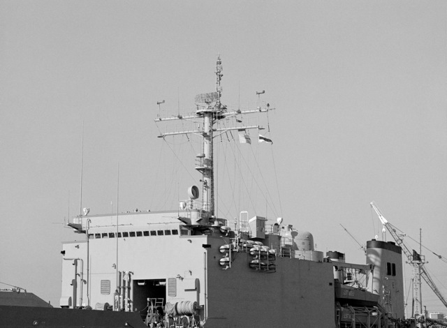 A port amidships view of the mast and superstructure of the tank landing ship USS BARBOUR COUNTY (LST 1195)