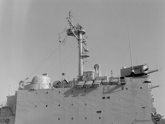 A starboard amidships view of the mast and superstructure of the tank landing ship USS BARBOUR COUNTY (LST 1195)