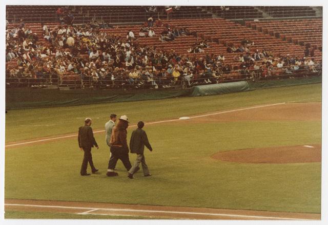 Smokey Bear, Bob Robbins, Ralph Cisco and Jim Vanmeter Walking to the Pitcher's Mound at Jack Murphy Stadium during Smokey Bear Baseball Card Night