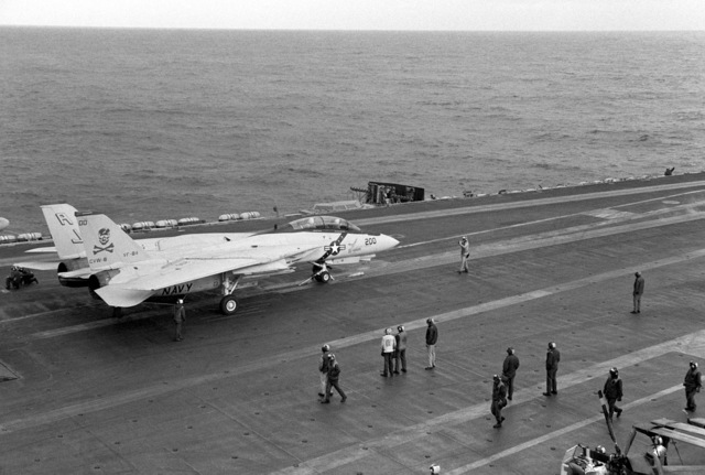 A Fighter Squadron 84 (VF-84) F-14A Tomcat aircraft waits for launch on the No. 3 waist catapult aboard the nuclear-powered aircraft carrier USS NIMITZ (CVN 68)