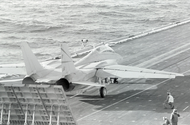 A Naval Air Reserve Fighter Squadron 302 (VF-302) F-14A Tomcat aircraft is prepared for launch from the aircraft carrier USS CONSTELLATION (CV 64)