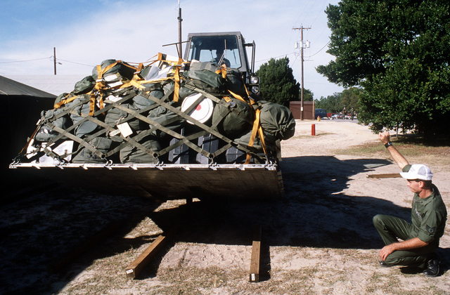 A pallet of supplies is transported by forklift during exercise Readiness Challenge '87. Exact Date Shot Unknown