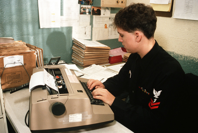 A personnelman types up discharge papers at the air station's Personnel Support Detachment