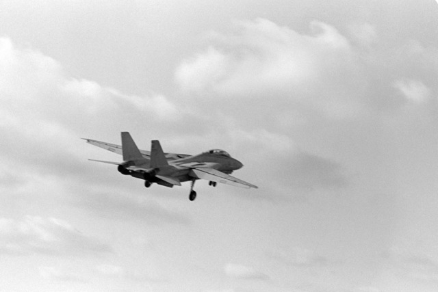 A right rear view of an F-14A Tomcat aircraft in flight shortly after being launched from the aircraft carrier USS CONSTELLATION (CV 64)