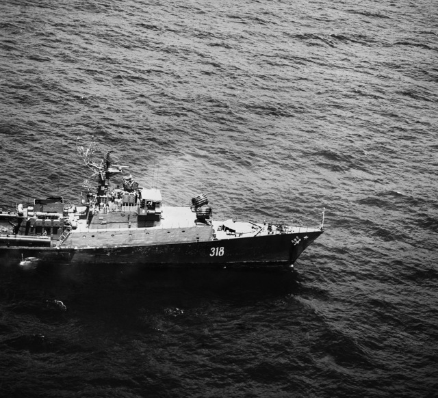 A starboard view of the bow of a Soviet Grisha III Class Anti-submarine Frigate displaying radar on the superstructure and anti-submarine weapons on deck