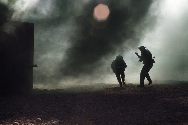 Aggressor forces attack in a simulated takeover of a village during Silver Flag Alpha, a security police training program emphasizing combat arms training and defense of priority resources on an air base