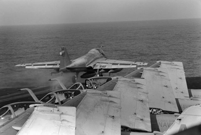 An A-6E Intruder aircraft is launched from the flight deck of the aircraft carrier USS JOHN F. KENNEDY (CV 67)
