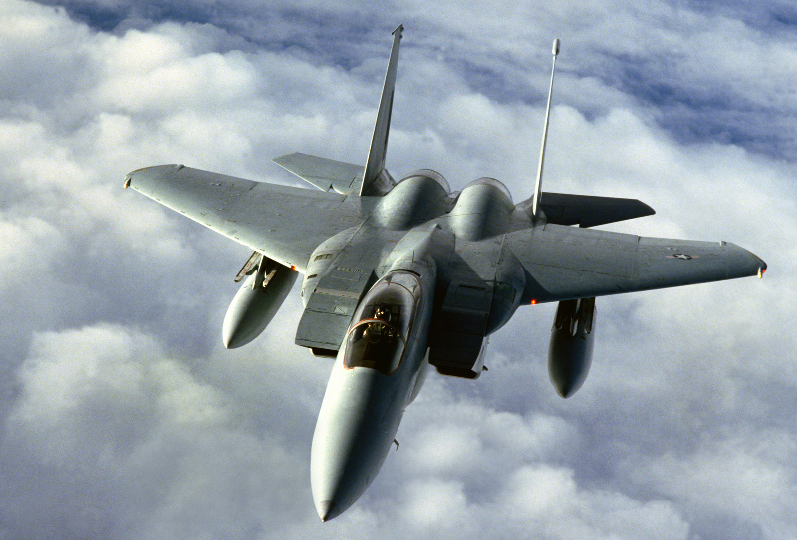 An air-to-air left front view of an F-15 Eagle aircraft en route to