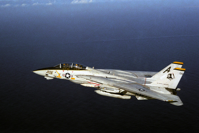 An air-to-air left side view of a Fighter Squadron 142 (VF-142) F-14A Tomcat aircraft.  The aircraft is assigned to the nuclear-powered aircraft carrier USS DWIGHT D. EISENHOWER (CVN 69)