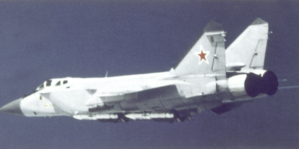 An air-to-air left side view of a Soviet MiG-31 Foxhound aircraft