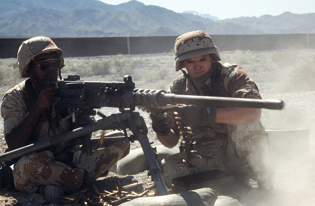 An airman fires an M-2 .50-caliber machine gun as his partner feeds rounds during Silver Flag Alpha, a security police training program emphasizing combat arms training and defense of priority resources on an air base