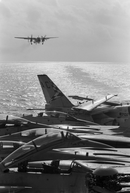 An E-2C Hawkeye aircraft approaches for a landing aboard the aircraft carrier USS JOHN F. KENNEDY (CV 67)