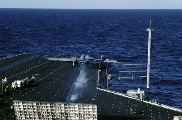 An F-14A Tomcat aircraft is launched during Naval Air Reserve carrier qualifications aboard the aircraft carrier USS CONSTELLATION (CV 64)