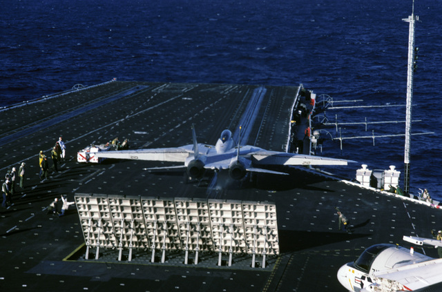 An F-14A Tomcat aircraft prepares to be launched during Naval Air Reserve carrier qualifications aboard the aircraft carrier USS CONSTELLATION (CV 64)