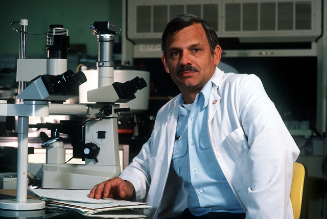 COL. (Dr.) Richard N. Boswell, an AIDS researcher at Wilford Hall U.S. Air Force Medical Center, works in a laboratory at the center