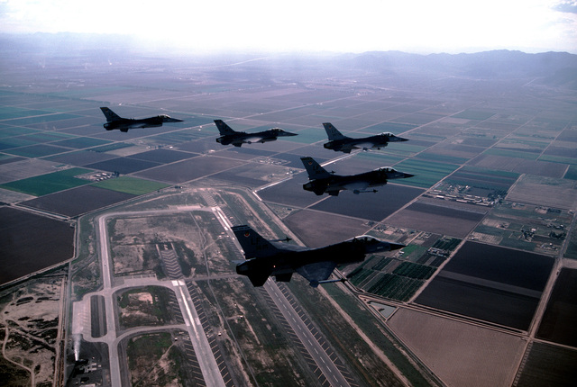 Five F-16 Fighting Falcon aircraft of the 58th Tactical Training Wing fly over Luke Air Force Base in wedge formation