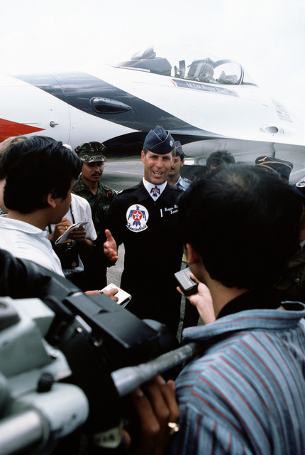 Lieutenant Colonel (LTC) Roger Riggs, commander of the US Air Force Thunderbirds flight demonstration team, conducts a planeside interview.  The Thunderbirds are performing in Indonesia as part of their 1987 Pacific tour which encompasses nine countries a