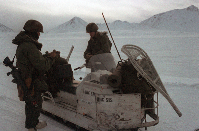 Members of the 616th Combat Control Group prepare for a snowmobile ride from Malemute Airstrip to their base camp during Exercise BRIM FROST'87