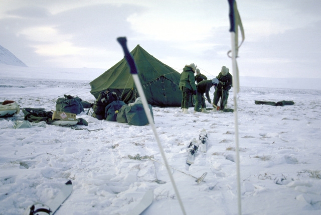 Members of the 722nd Combat Control Squadron and the 616th Combat Control Group erect a tentduring exercise Brim Frost '87