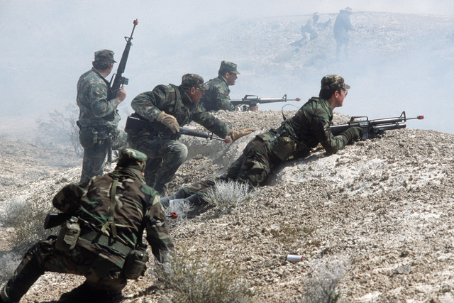 Reservists armed with M-16 rifles advance toward enemy forces during Silver Flag Alpha, a security police training program emphasizing combat arms training and defense of priority resources on an air base