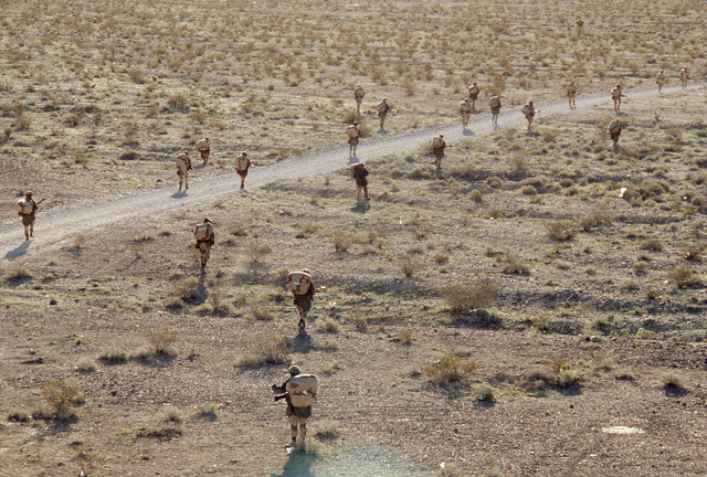 Reservists trek across the desert during Silver Flag Alpha, a security police training program emphasizing combat arms training and defense of priority resources on an air base