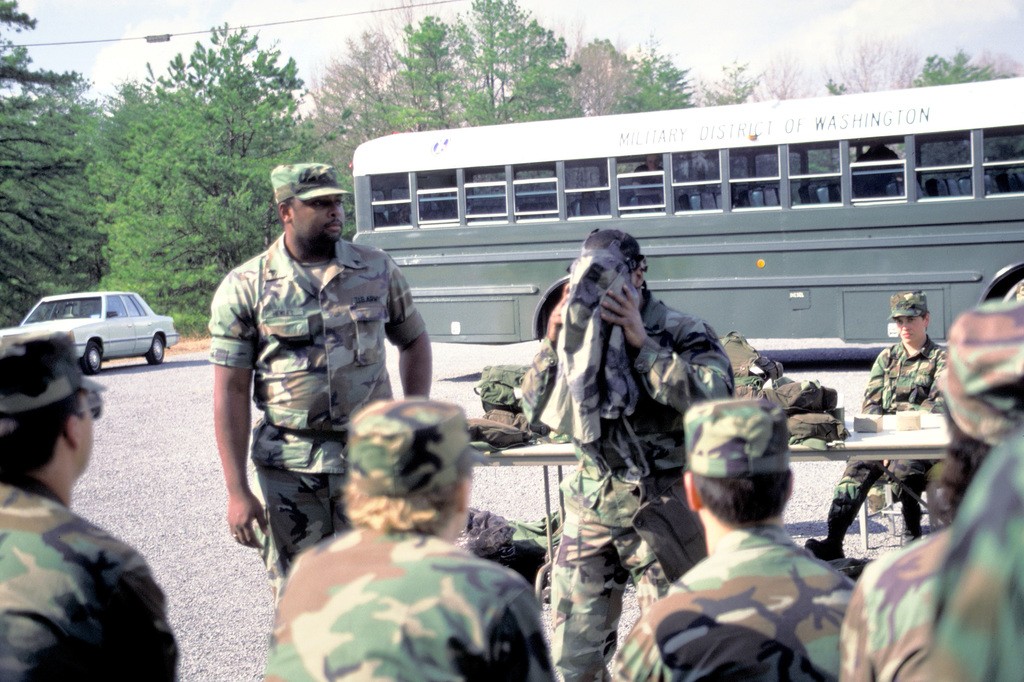 Soldiers of the 1101st Signal Brigade are instructed in the use of protective masks during common task training