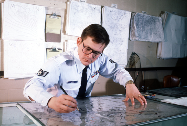 SSGT Stan Grell draws color-coded lines on a weather map to depict whirling air currents. Grell is one of 27 analysts working for the Space Environmental Support System of Air Force Global Weather Central. The system is divided into six Air Force solar observatories in Europe, North America and the Pacific and focuses attention on solar flares and their affect on the Earth's magnetic field