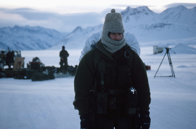 Staff Sergeant (SSG) Joe Scarbrough, 722nd Combat Control Squadron, carries his pack from the drop point during Exercise BRIM FROST'87