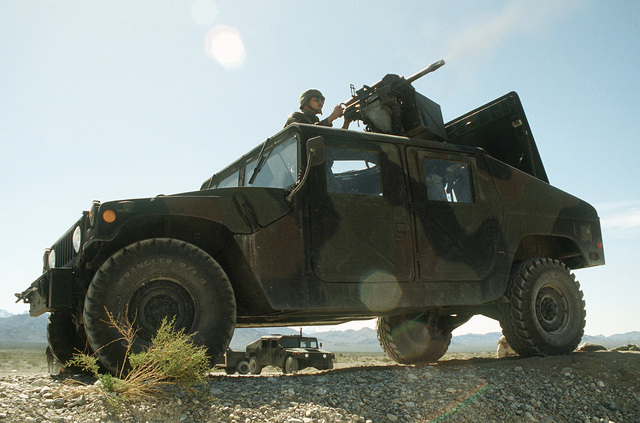 STAFF SGT. Bill E. Jones, 27th Security Police Squadron, fires a 40mm Mark 19 automatic grenade launcher mounted atop an M998 High-Mobility Multipurpose Wheeled Vehicle (HMMWV) during Silver Flag Alpha, a security police training program emphasizing combat arms training and defense of priority resources on an air base