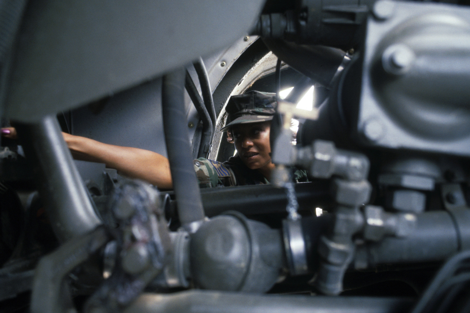 Technical Sergeant (TSGT) Gale Pafe, non-commissioned officer in charge of the dispersal curriculum development, 868th Tactical Missile Training Group, works on a MAN truck engine