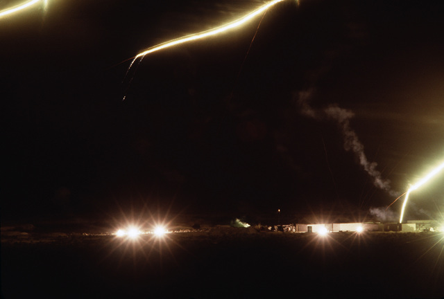 Tracer fire lights the night sky during a simulated village takeover, part of Silver Flag Alpha, a security police training program emphasizing combat arms training and defense of priority resources on an air base