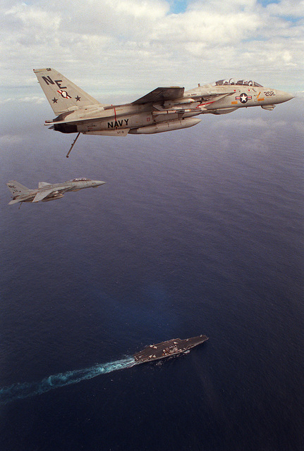 Two Fighter Squadron 2 (VF-2) F-14A Tomcat aircraft pass over the aircraft carrier USS RANGER (CV-61)