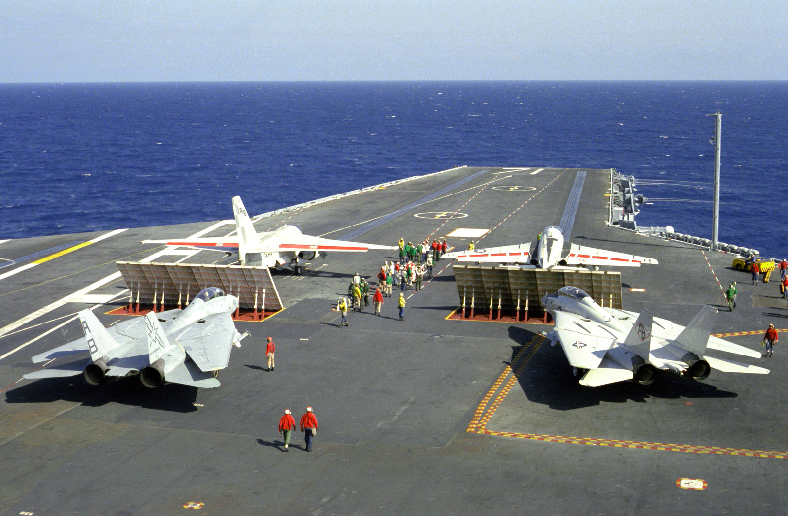 An S-3A Viking aircraft, left, and an A-6E Intruder aircraft are in position for launch on the flight deck of the nuclear-powered aircraft carrier USS THEODORE ROOSEVELT (CVN-71). Behind each blast deflector is an F-14A Tomcat aircraft. The aircraft, the pilots of which are working toward their carrier qualifications, are from Carrier Air Wing 1 (CVW-1), the wing assigned to the aircraft carrier USS AMERICA (CV-66)