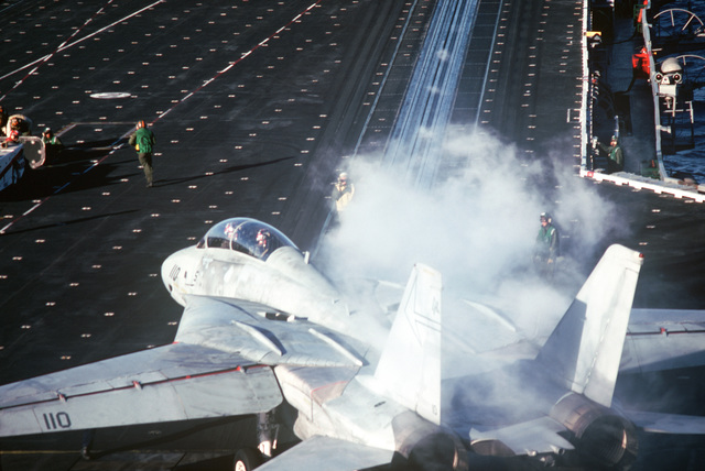 A Naval Air Reserve Fighter Squadron 301 (VF-301) F-14A Tomcat aircraft is positioned on a catapult during carrier qualifications aboard the aircraft carrier USS CONSTELLATION (CV 64)