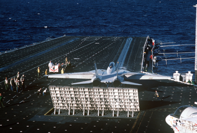 Firefighters and catapult and arresting gear crewmen stand by as a Naval Air Reserve Fighter Squadron 301 (VF-301) F-14A Tomcat aircraft prepares to be launched during carrier qualifications aboard the aircraft carrier USS CONSTELLATION (CV 64)