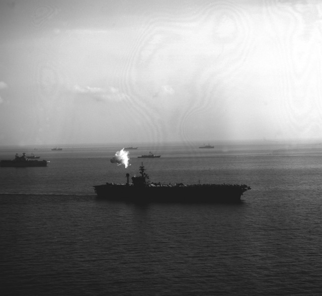 A starboard bow view of the aircraft carrier USS JOHN F. KENNEDY (CV-67) underway with its battle group escorts