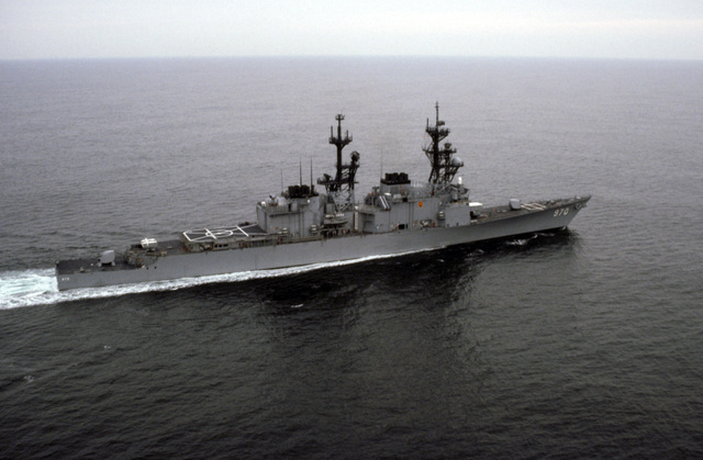 A starboard quarter view of the destroyer USS CARON (DD 970) underway off the Virginia Capes