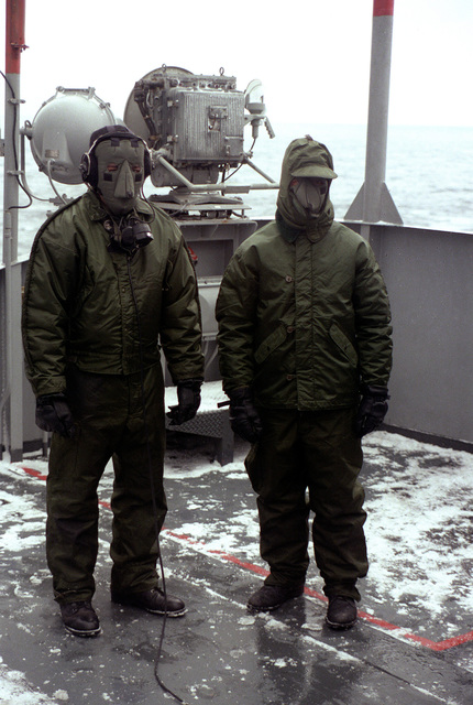 Flight deck crewmen dressed in foul weather gear pose for a photograph during flight operations aboard the nuclear-powered aircraft carrier USS CARL VINSON (CVN-70)