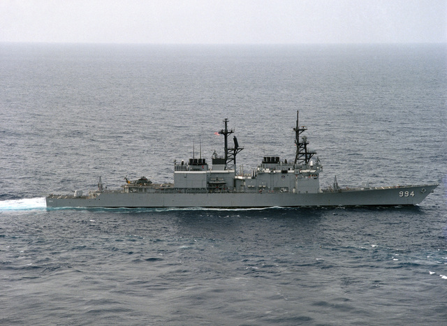 An aerial starboard beam view of the guided missile destroyer USS CALLAGHAN (DDG 994) underway