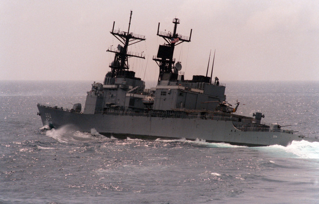 A port quarter view of the guided missile destroyer USS CALLAGHAN (DDG 994) underway