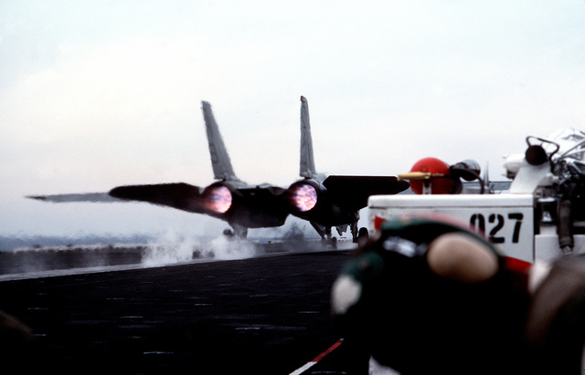 A Fighter Squadron 33 (VF-33) F-14A Tomcat aircraft is launched from the flight deck of the nuclear-powered aircraft carrier USS THEODORE ROOSEVELT (CVN 71)
