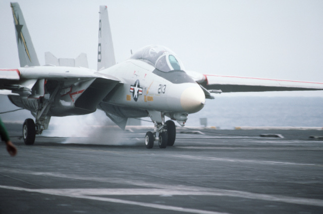 An F-14A Tomcat aircraft engages an arresting cable aboard the nuclear-powered aircraft carrier USS THEODORE ROOSEVELT (CVN 71)