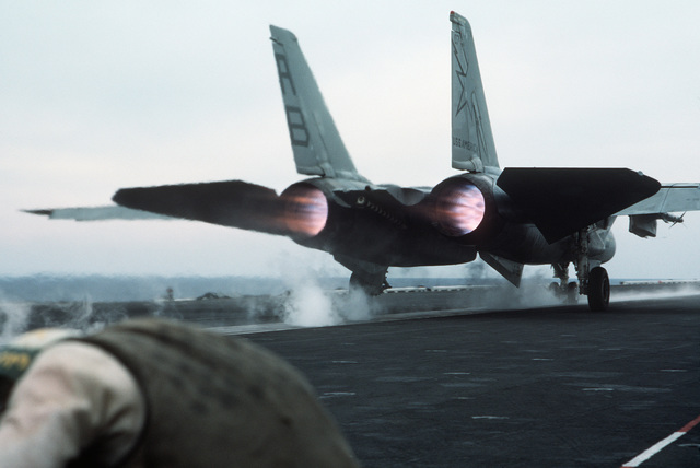 An F-14A Tomcat aircraft is launched from the nuclear-powered aircraft carrier USS THEODORE ROOSEVELT (CVN 71)